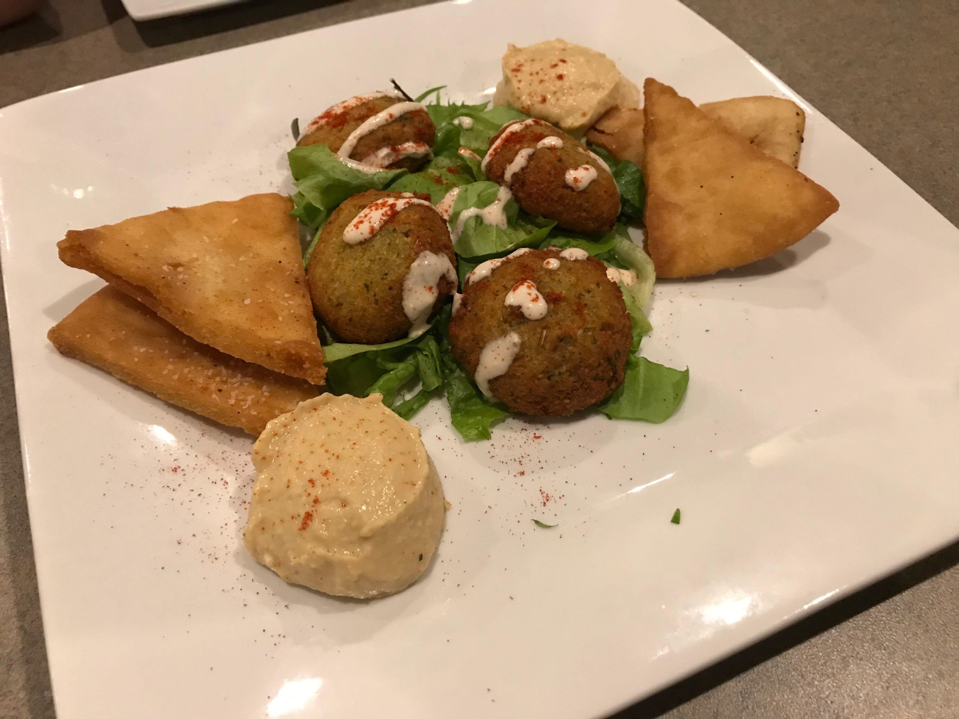 This falafel appetizer at Holla came with garlic and lemon hummus and pita chips.