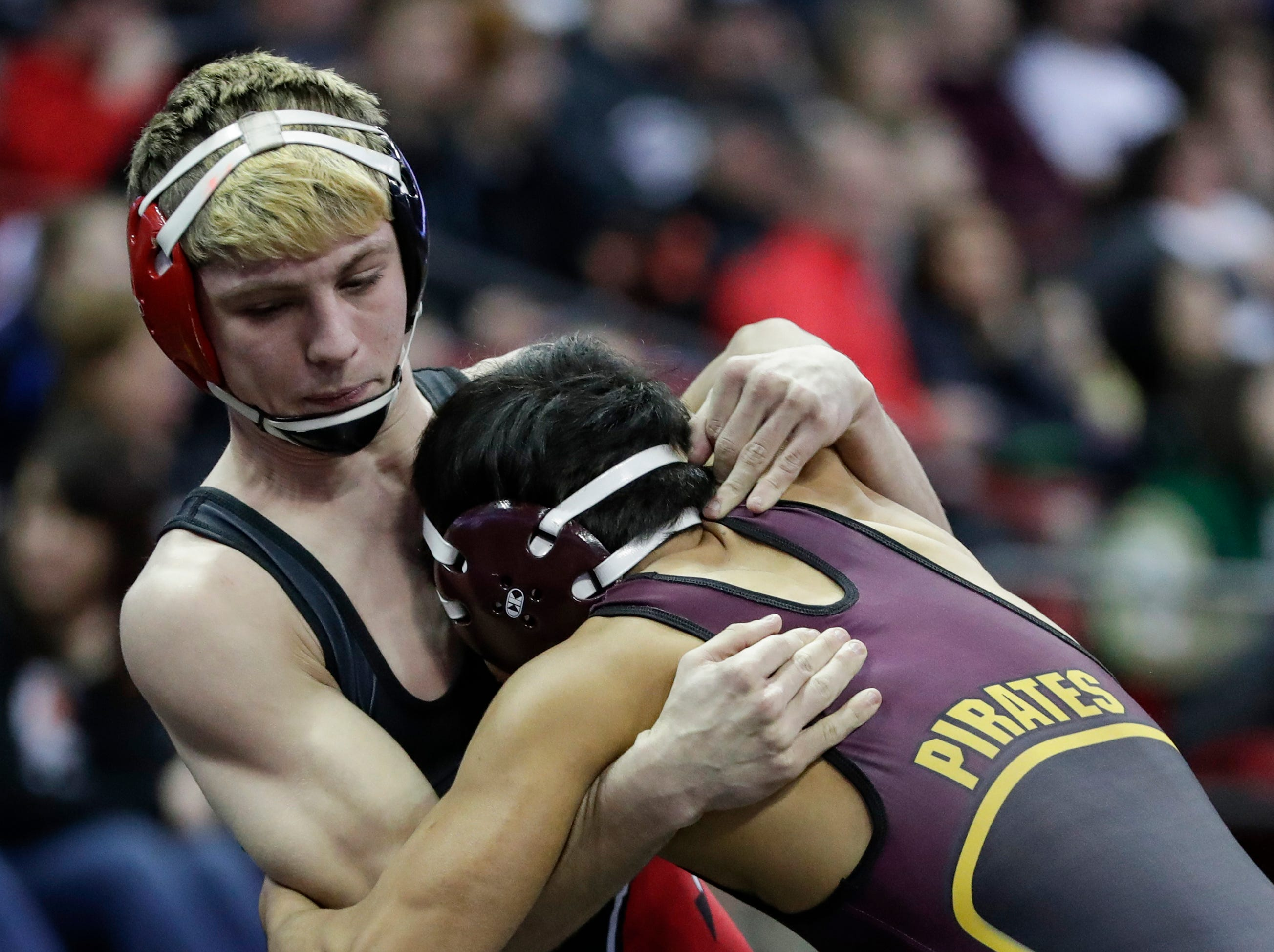 Weyauwega-Fremont's Justin Kempf wrestles Waterloo's Carlos Garcia in a Division 3 132-pound weight class preliminary match during the WIAA state individual wrestling tournament at the Kohl Center Thursday, February 21, 2019, in Madison, Wis.