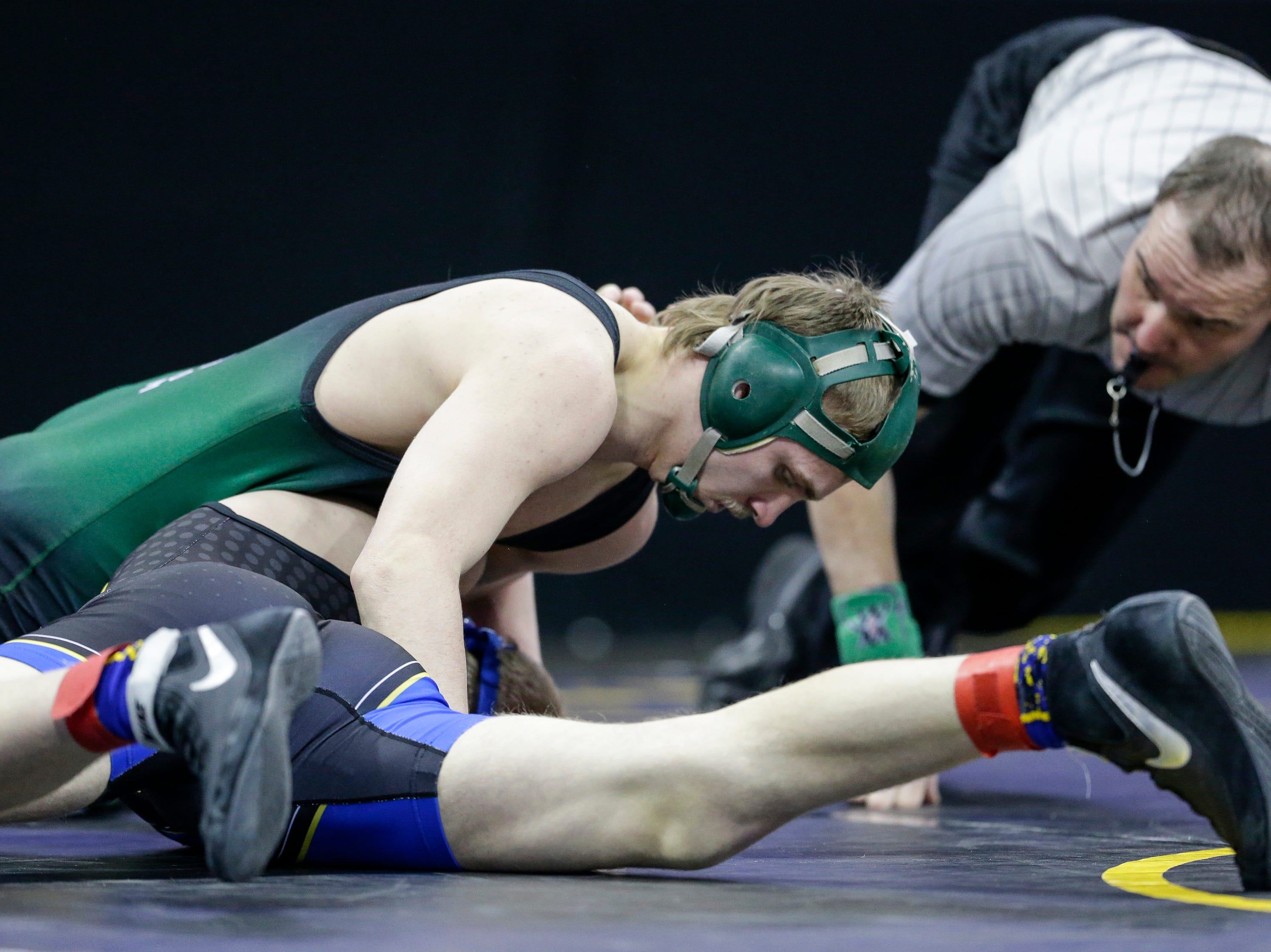 Shioctin's Billy Reif wrestles Shell Lake's Cory Kidder in a Division 3 160-pound weight class preliminary match during the WIAA state individual wrestling tournament at the Kohl Center Thursday, February 21, 2019, in Madison, Wis.