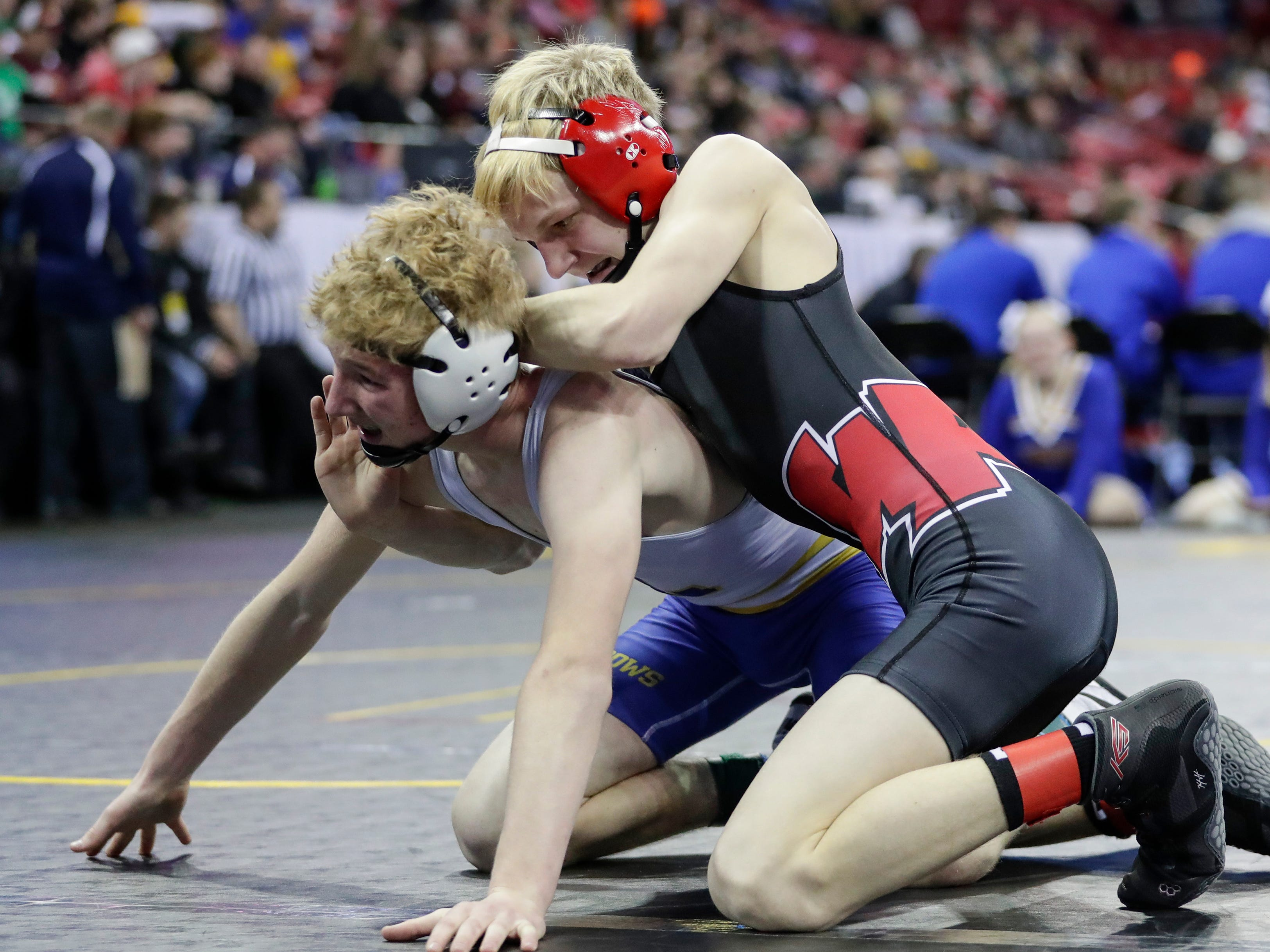 Weyauwega-Fremont's Carter Greening wrestles Lancaster's Carter Lull in a Division 3 113-pound weight class preliminary match during the WIAA state individual wrestling tournament at the Kohl Center Thursday, February 21, 2019, in Madison, Wis.