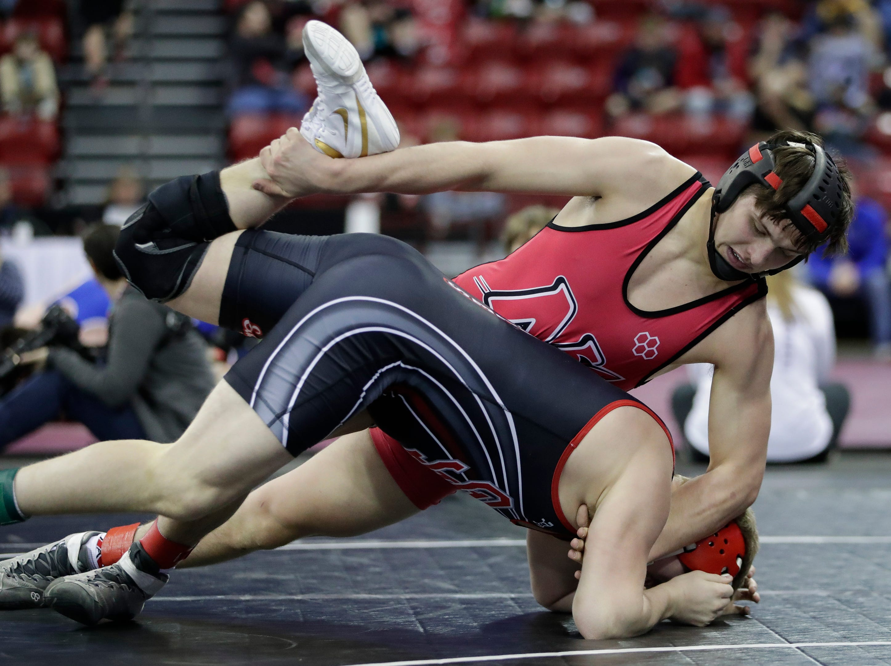 Neenah's Marshall Kools wrestles Sauk Prairie's Marcus Hankins in a Division 1 195-pound weight class preliminary match during the WIAA state individual wrestling tournament at the Kohl Center Thursday, February 21, 2019, in Madison, Wis.