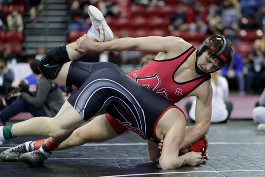 Neenah's Marshall Kools wrestles Sauk Prairie's Marcus Hankins in a Division 1 195-pound preliminary match Thursday during the WIAA state individual wrestling tournament at the Kohl Center in Madison.
