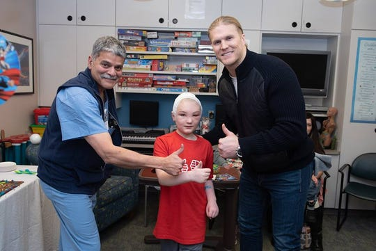 Green Bay Packers linebacker Clay Matthews visits with a patient at Marshfield Children's Hospital Wednesday, February 20, 2019.