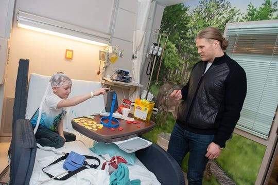 Green Bay Packers linebacker Clay Matthews plays games with a patient at Marshfield Children's Hospital Wednesday, February 20, 2019.