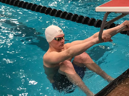 Crestview's Ross Kuhn prepares to launch in his heat of the 100 backstroke at the 2019 state swim meet. Kuhn has also competed in the state track meet and this past football quarterbacked the  Cougars into the state playoffs.