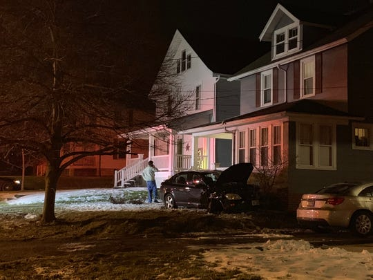 A car came to rest in a yard following a crash involving two vehicles Thursday, February 21, 2019.