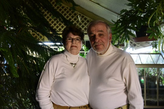 Don and Shirley Lambright stand inside their greenhouse in Madison Township. The couple never strayed far from where they met in high school, the former Union School  — now the Crestview Local School District.