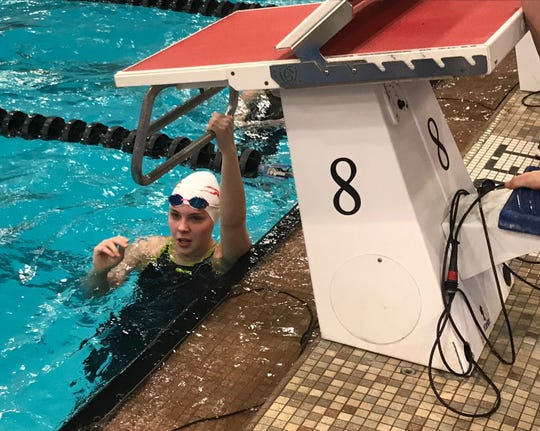 Shelby sophomore Kassie Stine, a two-time qualifier, checks her time on the scoreboard after her heat of the 50 free at the state swim meet.