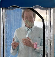 Doc Stumbo tries his hand at the United Way Dash to Goal Money Machine on Friday morning at Graham Chevrolet.
