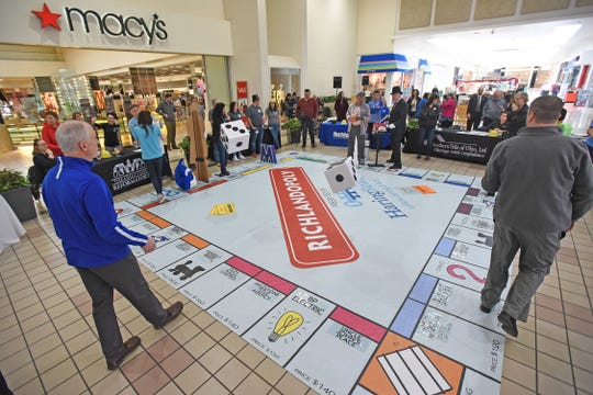 Local businesses and organizations play Richlandopoly on Friday at the Richland Mall.