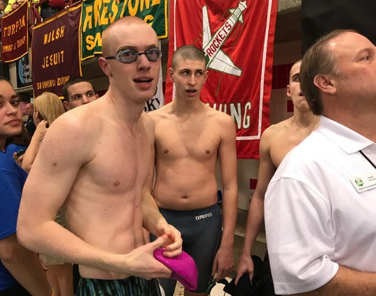 Lexington senior Connor Miller has reason to smile after he improved from 13th seed to 8th in the prelims of the 50 free to put himself in position for three medals at the state swim meet.
