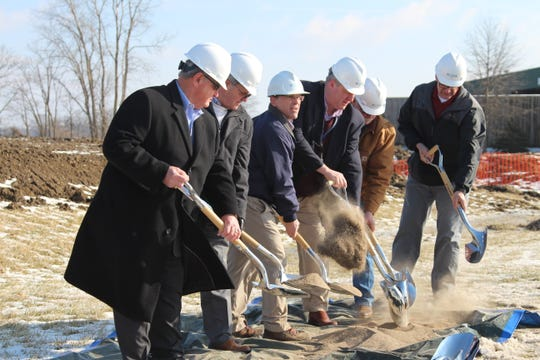 Officials with Aqua Ohio, the Marion County Commission and Tri-Rivers Career Center take part in a ground-breaking ceremony for an estimated $2.78 million water tower being built behind the Tri-Rivers campus.