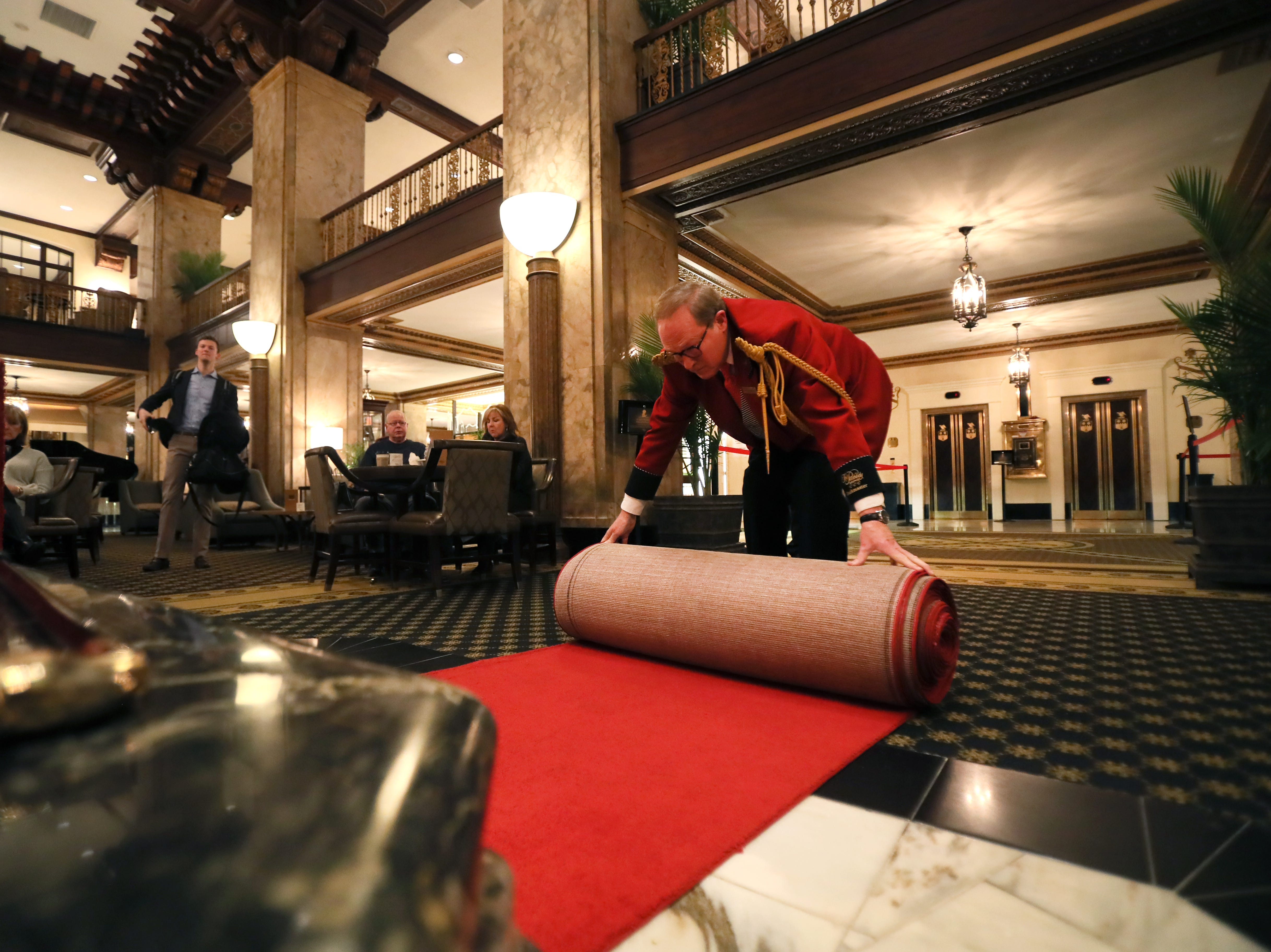 Doug Weatherford, Duckmaster at the Peabody Hotel, rolls out the red carpet for his fowl troop at the downtown Memphis landmark on Thursday, Feb. 21, 2019.