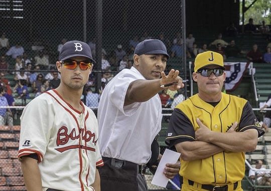 Southaven resident Javerro January (middle) gives pregame instructions in a Southern League matchup between Birmingham and Jacksonville. January is entering his 10th year of umpiring baseball.