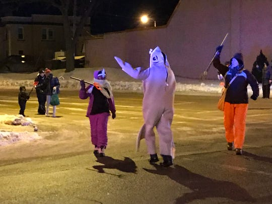 Temperatures close to zero didn't derail the Running of the Sturgeon Parade in downtown Fond du Lac on Feb. 8 during Fond du Lac's Sturgeon Spectacular, where a reporter interviewed Wisconsin voters about next year's presidential election.