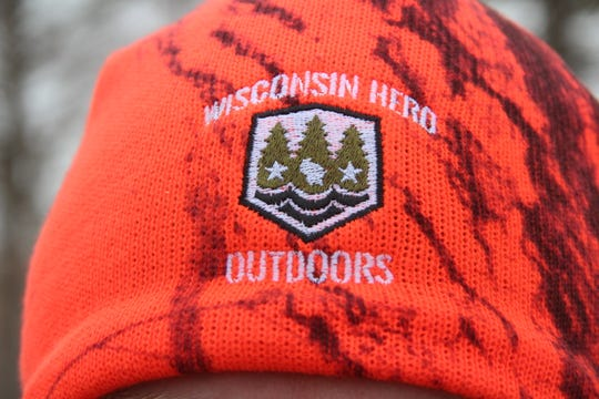 A hat displays the logo for Wisconsin Hero Outdoors, a non-profit charity that serves military veterans, first responders and their families.