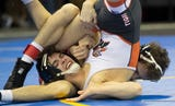 Local wrestlers position themselves for titles by advancing in the state tournament.
