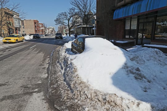 February 22, 2019 Parked car buried in snow yet almost a week since last snow started.  Its located in the 1400 block of North Farwell Avenue in Milwaukee.