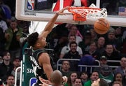 Bucks forward Giannis Antetokounmpo elevates for a slam dunk.