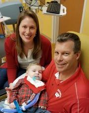 Ashley Hilgemann and Justin Hilgemann spend time with their son Derek at Children's Hospital.