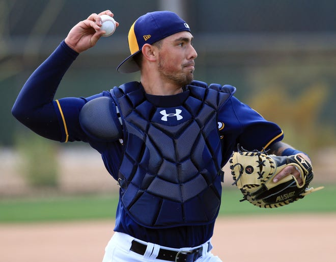Brewers catcher Jacob Nottingham throws to first base during spring training drills Feb. 17 in Phoenix.