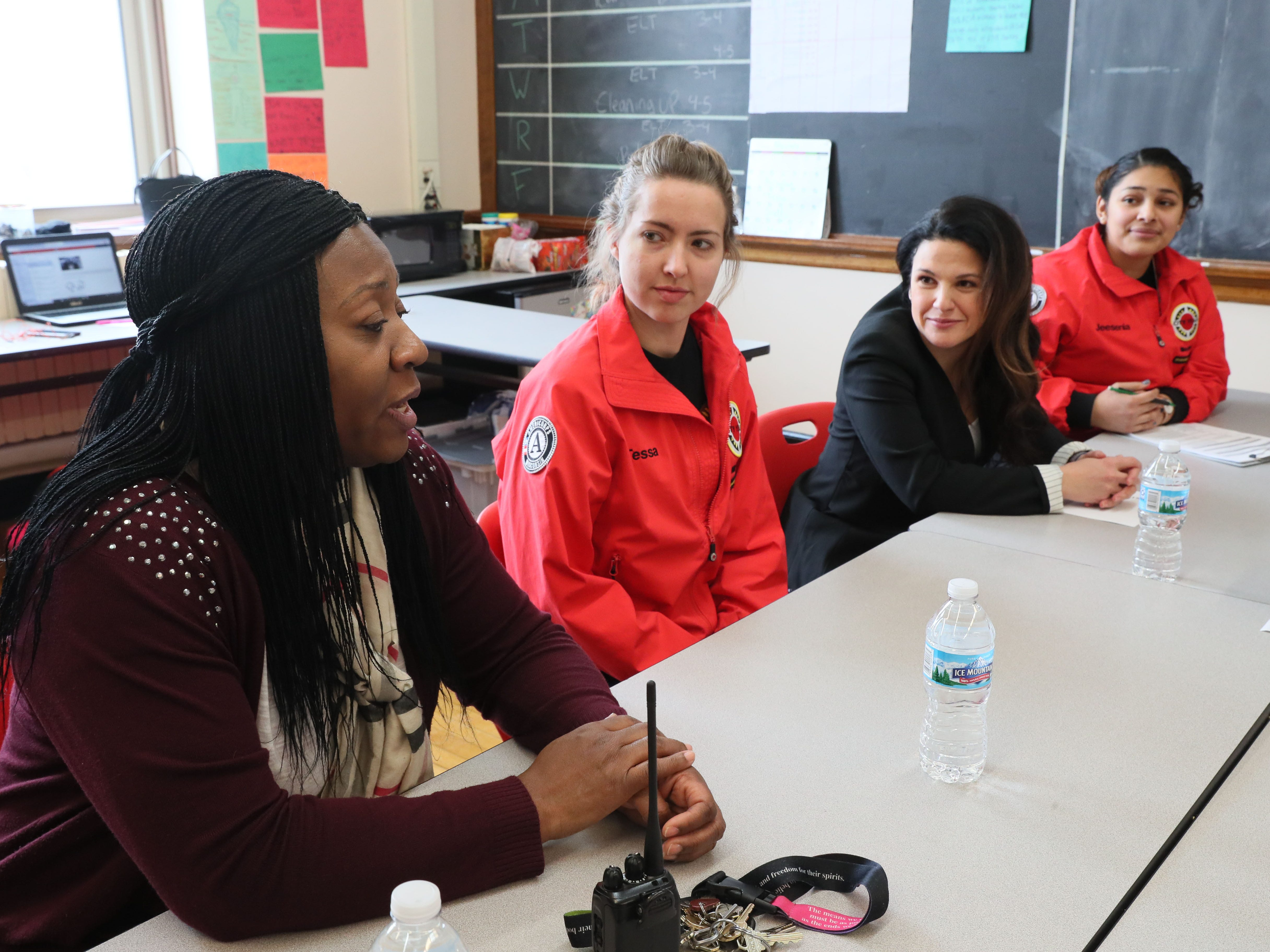 Discussing the City Year program and how it works are (from left) Pulaski Principal Lolita Patrick; Tessa Rhodes, City Year student success coach; Meralis T. Hood, executive director; and Jeesenia Zavala, team leader.