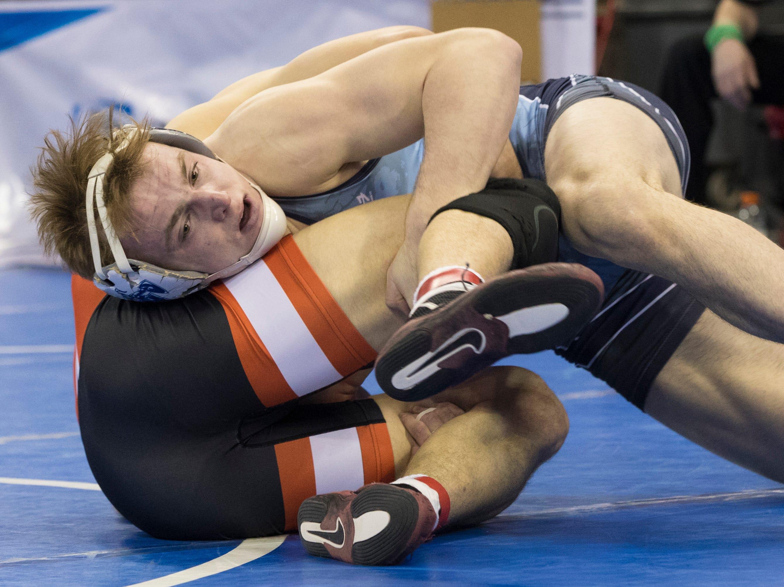 Nicolet's Parker Keckeisen (front) defeats Marshfield's Bentley Schwanebeck-Ostermann in a 182- pound quarterfinal.