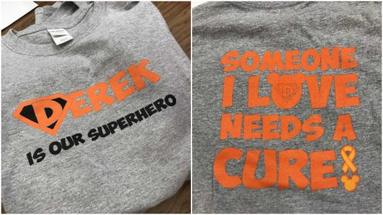 """The shirts the students sold for Derek said """"Derek Is Our Superhero"""" on the front and """"Someone I Love Needs A Cure"""" on the back."""