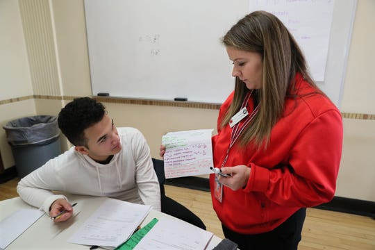 Pulaski High School freshman Daren Rosario (left) works on a math lesson with success coach Stella Tomich of City Year.