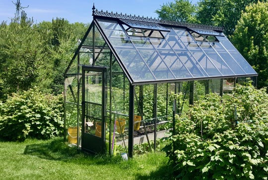Petr Kolarsky and his family of eight get a jump on spring transplants with their charming backyard greenhouse in Waunakee.