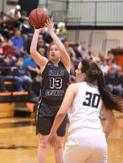 Izard County's Maura Thomason puts up a shot against Maynard on Thursday night.