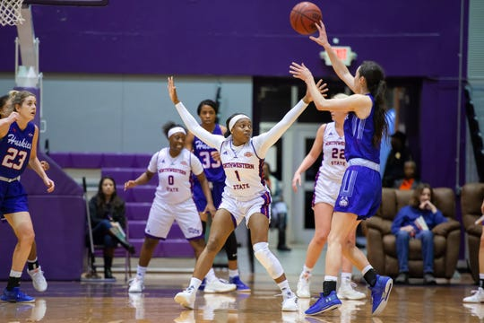 NSU's Gabby Bell (1) and the Lady Demons played stellar defense Thursday.