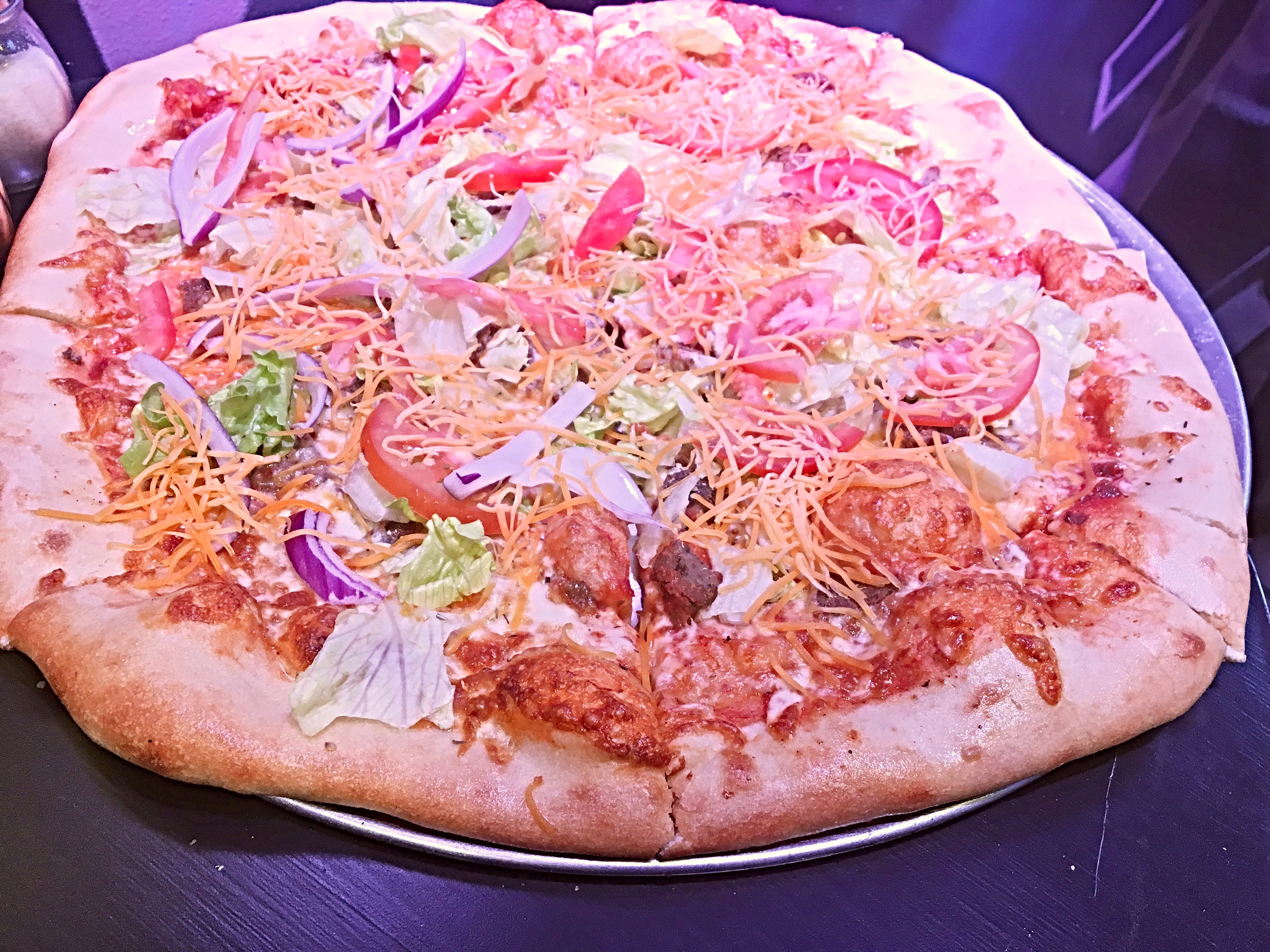 Taco pizza at Spinelli's features everything you'd have on a taco: ground beef, onions, tomatoes, lettuce and cheese.