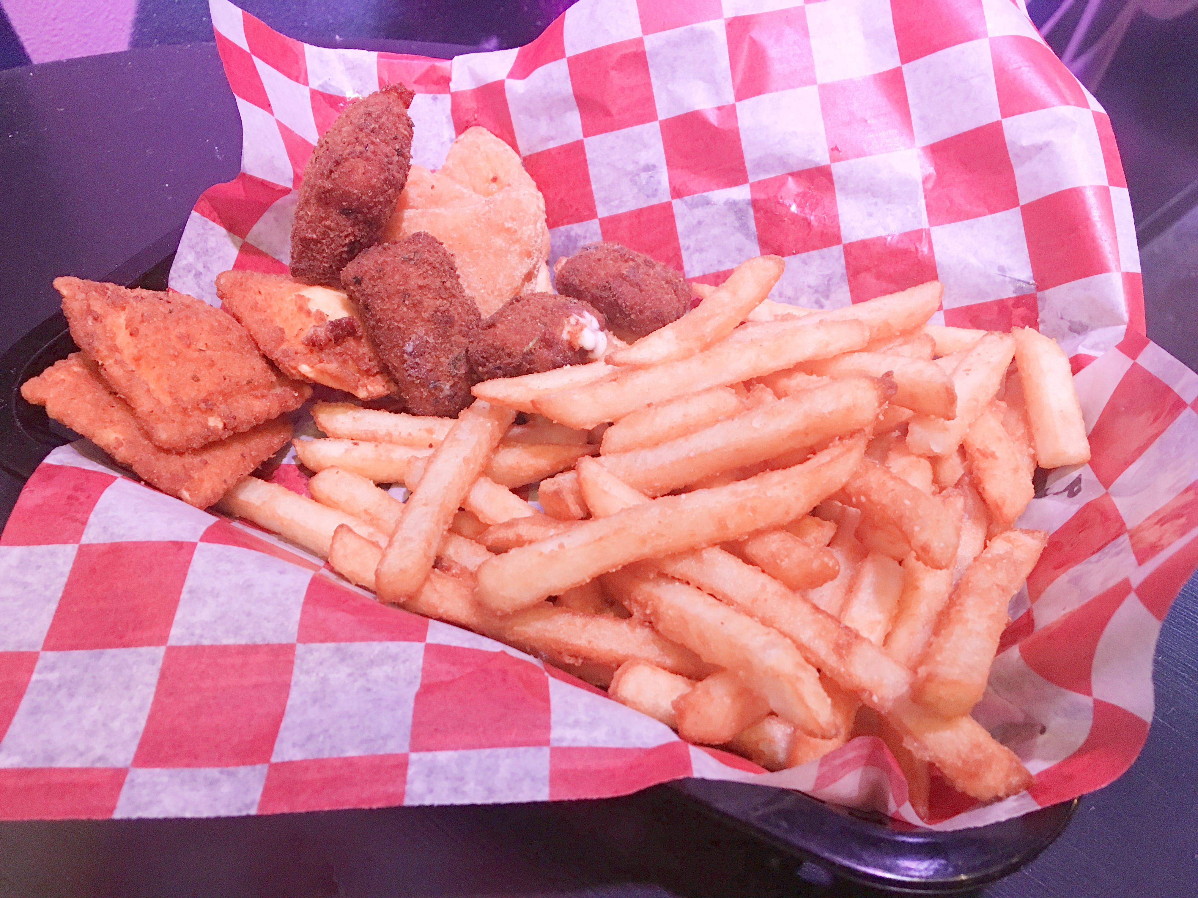 Spinelli's Pizzeria's appetizer features fried ravioli, mac-n-cheese bites, mozzarella bites and fries.