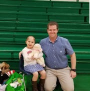Haleigh Peden-Clemons with youth minister Tyler Binkley.