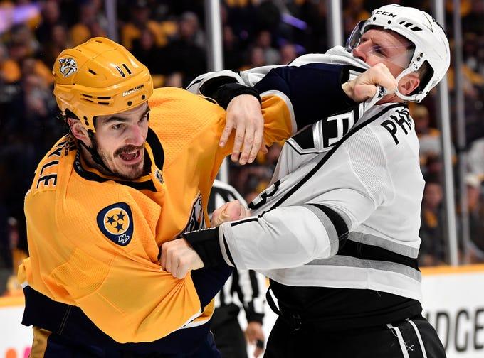 Predators center Brian Boyle (11) fights Kings defenseman Dion Phaneuf (3) during the first period at Bridgestone Arena Thursday, Feb. 21, 2019 in Nashville, Tenn.