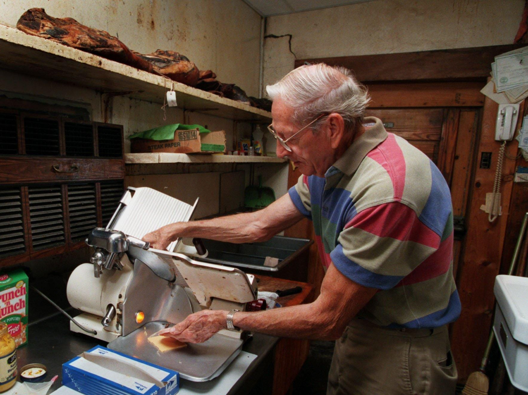 The late Waymen Terry , owner of Terry's Market in Gallatin cuts up thick slices of meat and cheese for sandwiches. Customers came from all over to buy the smoked and aged meats that Waymen and his son, Ronnie Terry sold in their small Gallatin market.