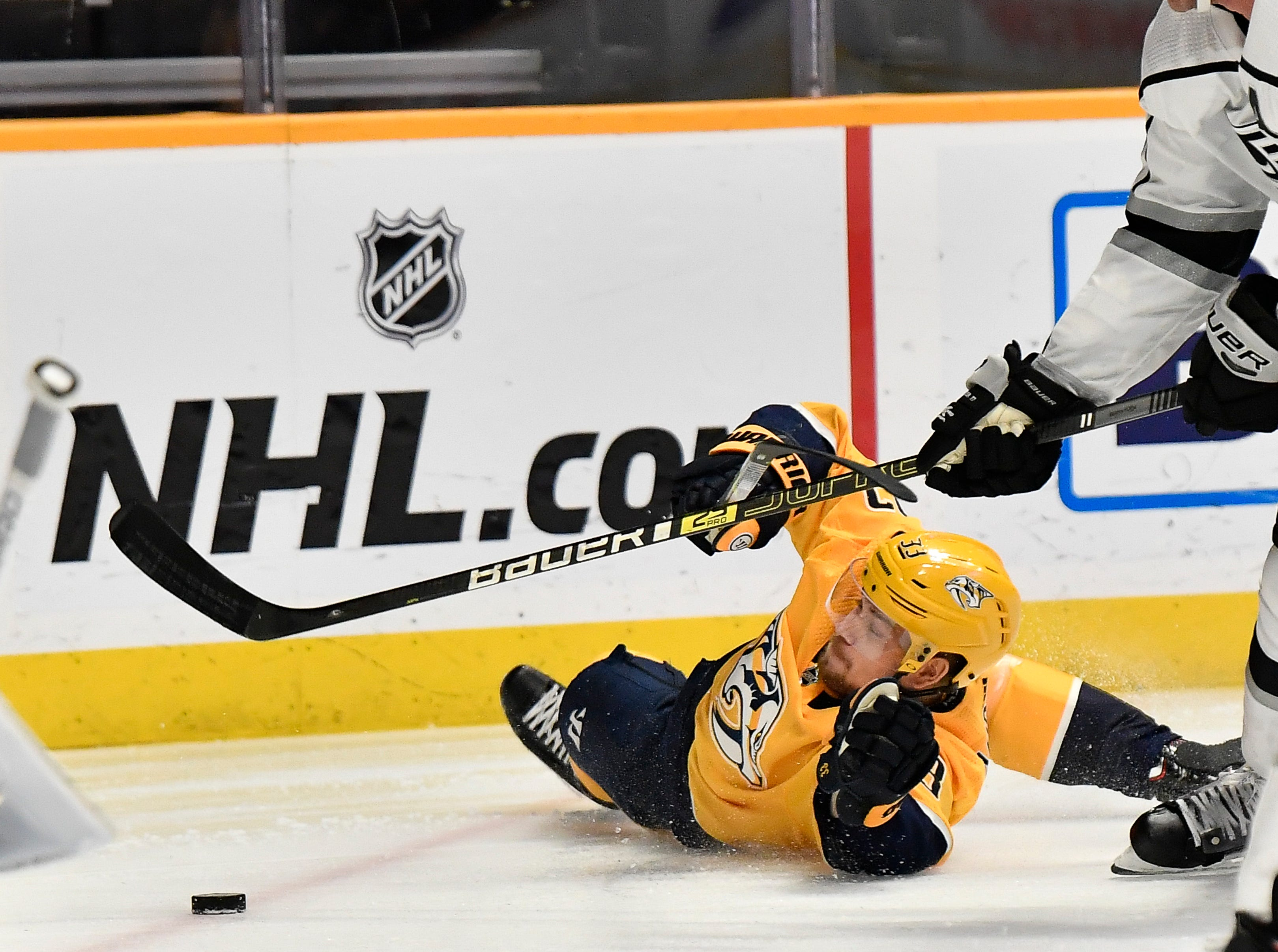 Predators right wing Viktor Arvidsson (33) falls to the ice as he attacks the goal against the Kings during the first period at Bridgestone Arena Thursday, Feb. 21, 2019 in Nashville, Tenn.