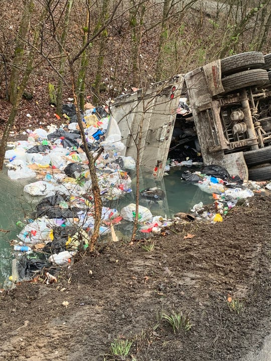 Cheatham County 911 reported an overturned semi hauling trash shut down Highway 70 on Friday morning.