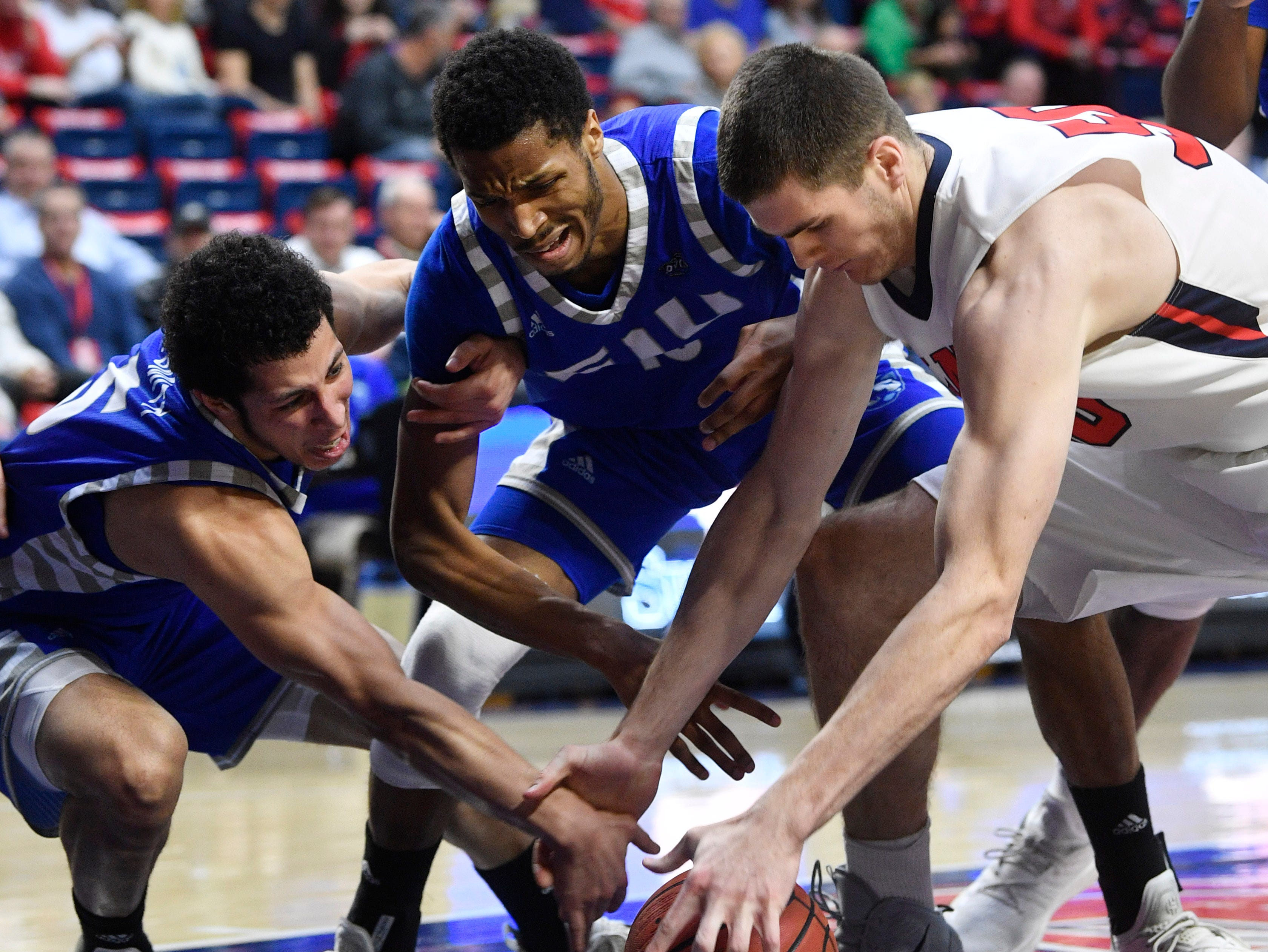 Seth Adelsperger fights for a loose ball as Belmont plays Eastern Illinois in Curb Event Center Thursday, Feb. 21, 2019, in Nashville, Tenn. Flood stage is 40 feet.