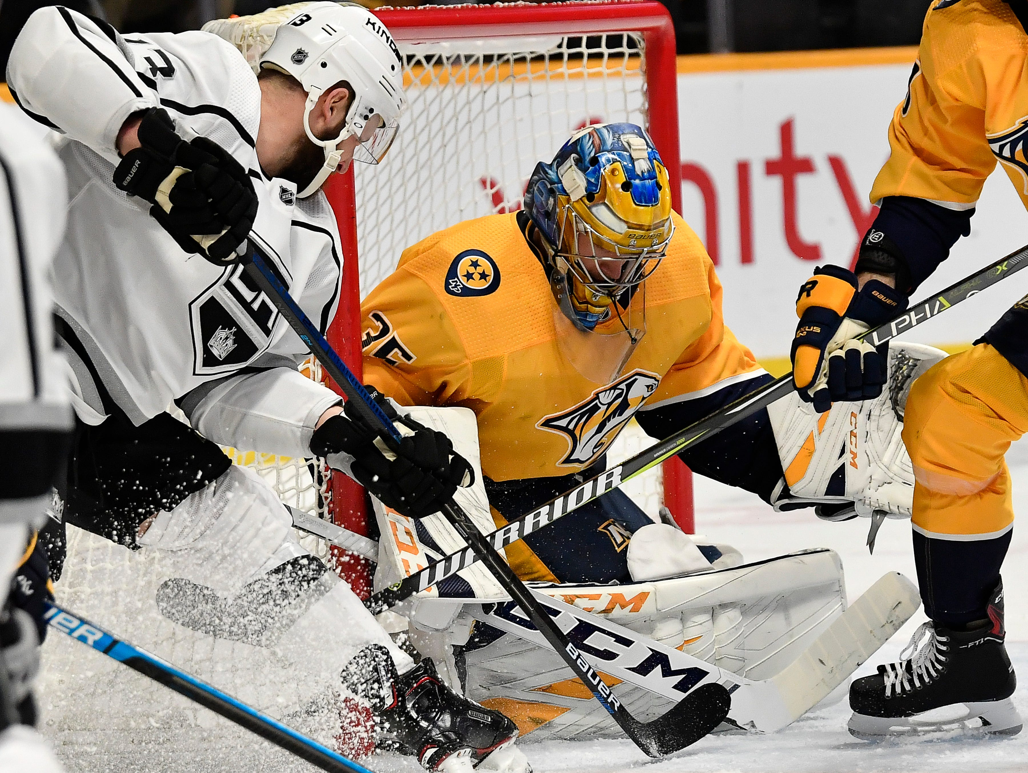 Predators goaltender Pekka Rinne (35) defends the goal as Kings left wing Kyle Clifford (13) attacks during the second period at Bridgestone Arena Thursday, Feb. 21, 2019 in Nashville, Tenn.