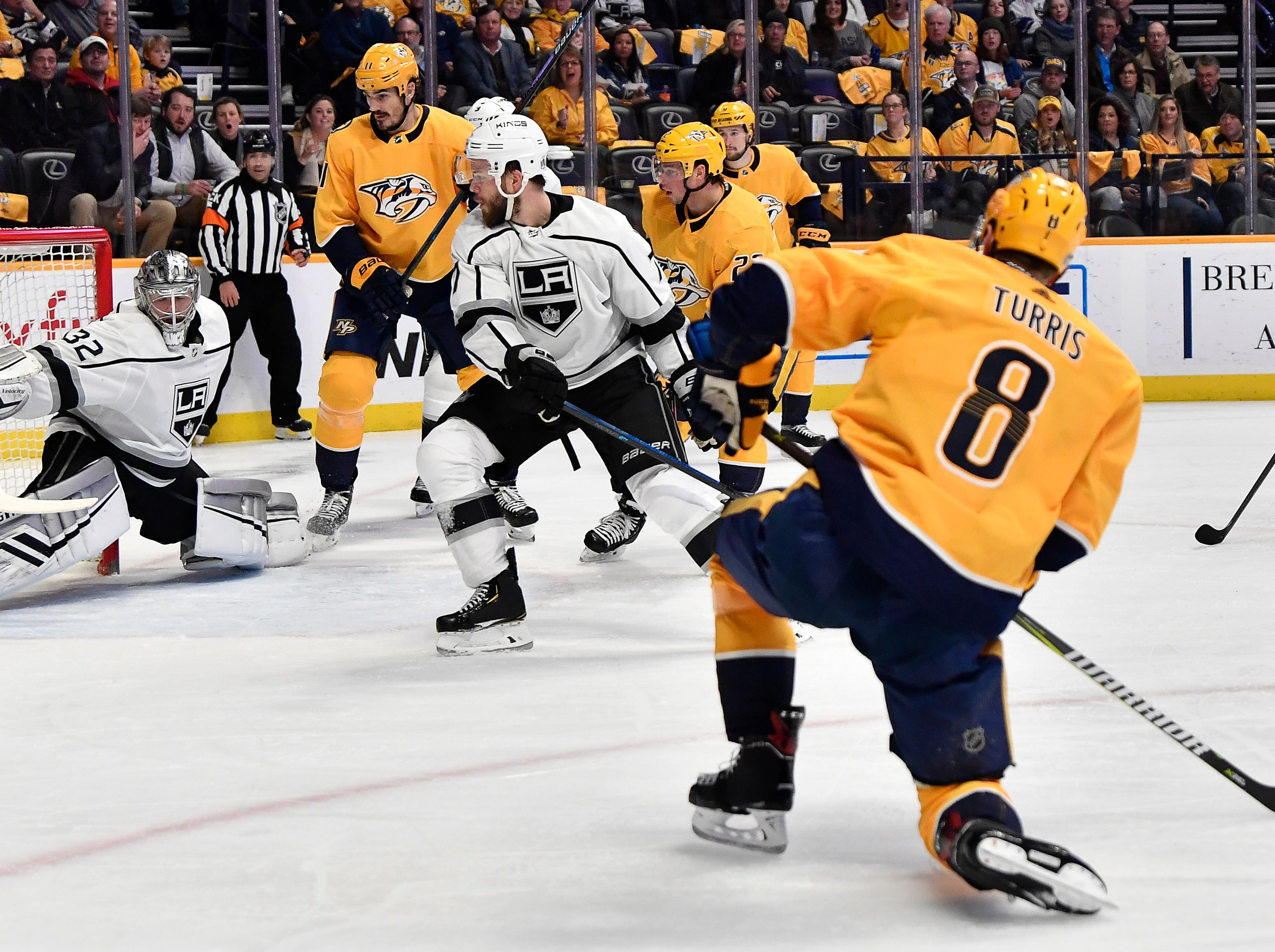 Predators center Kyle Turris (8) scores a goal past Kings goaltender Jonathan Quick (32) during the first period at Bridgestone Arena Thursday, Feb. 21, 2019 in Nashville, Tenn.