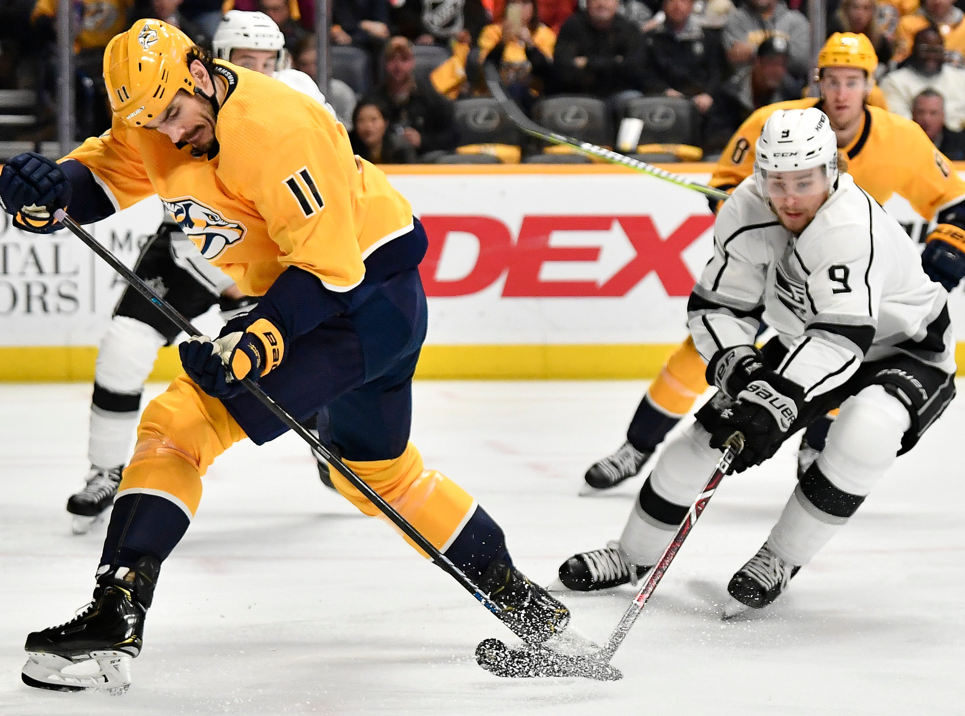 Predators center Brian Boyle (11) takes the puck from Kings center Adrian Kempe (9) during the first period at Bridgestone Arena Thursday, Feb. 21, 2019 in Nashville, Tenn.
