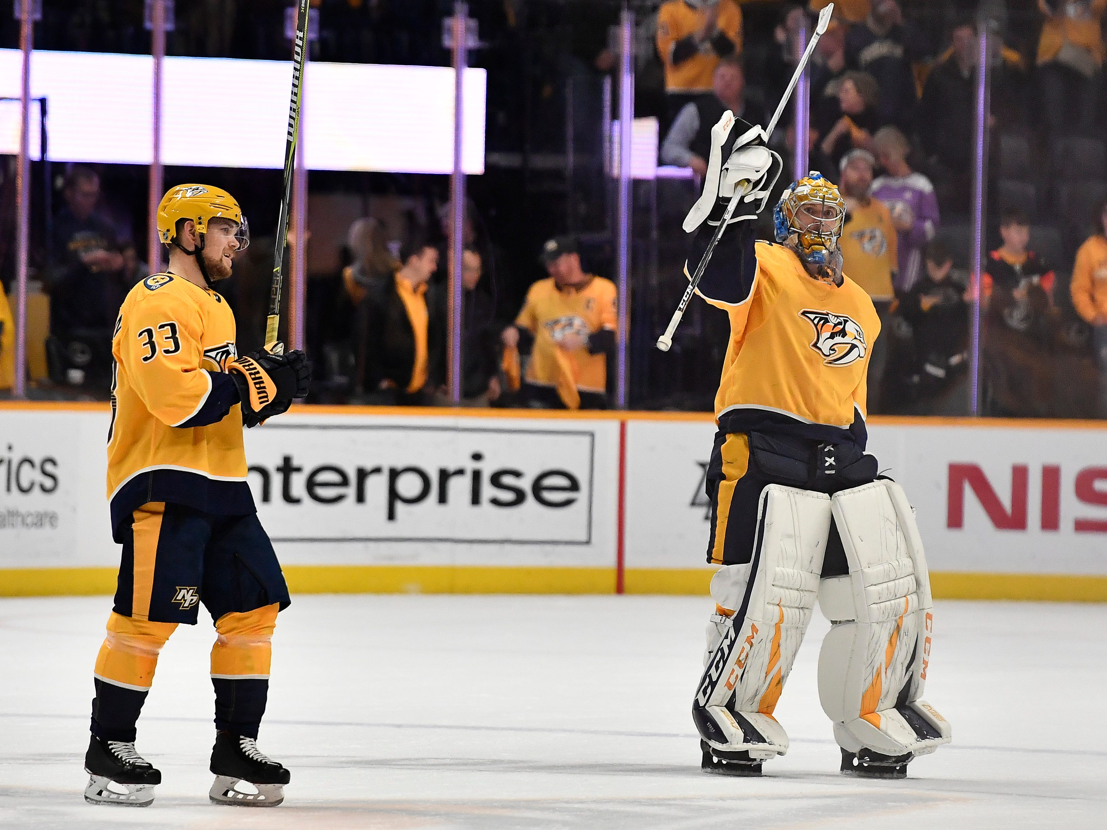 Predators right wing Viktor Arvidsson (33) and goaltender Pekka Rinne (35) wave to the crowd after their 2 to 1 victory against the Kings at Bridgestone Arena Thursday, Feb. 21, 2019 in Nashville, Tenn.