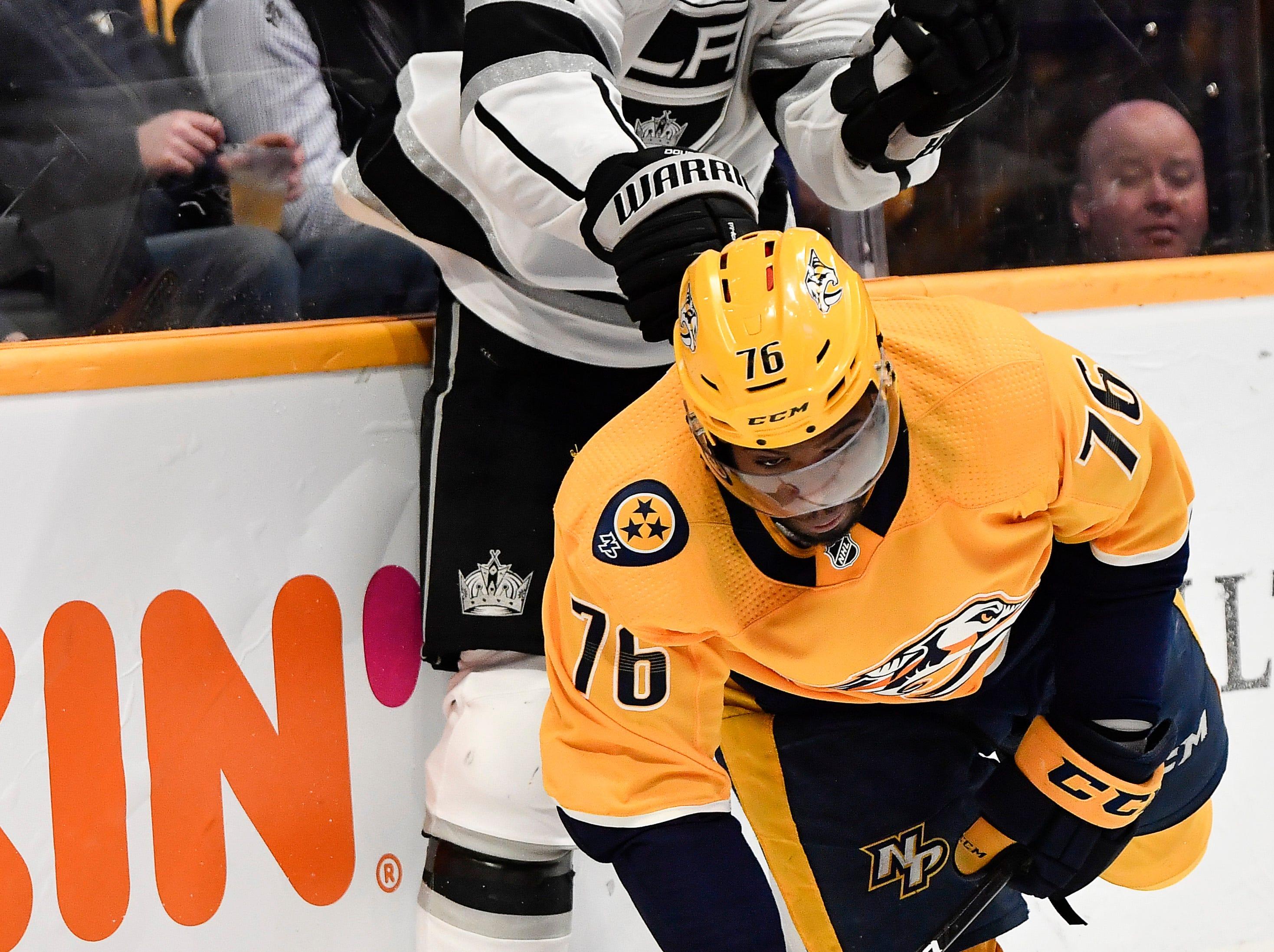 Predators defenseman P.K. Subban (76) passes the puck past Kings defenseman Drew Doughty (8) last he falls to the ice during the third period at Bridgestone Arena Thursday, Feb. 21, 2019 in Nashville, Tenn.