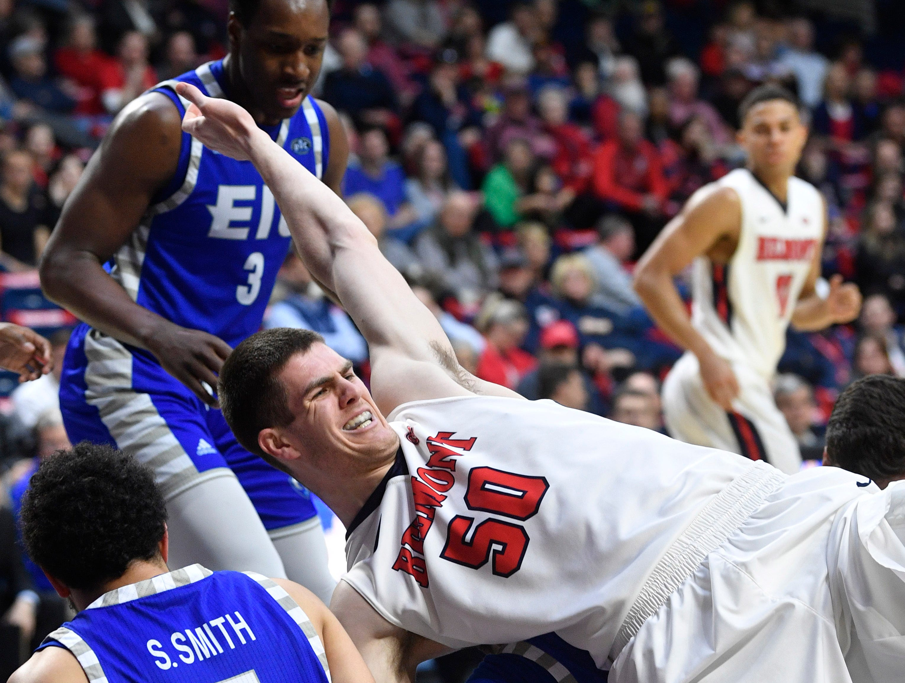 Seth Adelsperger gets his leg twisted going for a loose ball as Belmont plays Eastern Illinois in Curb Event Center Thursday, Feb. 21, 2019, in Nashville, Tenn. Flood stage is 40 feet.