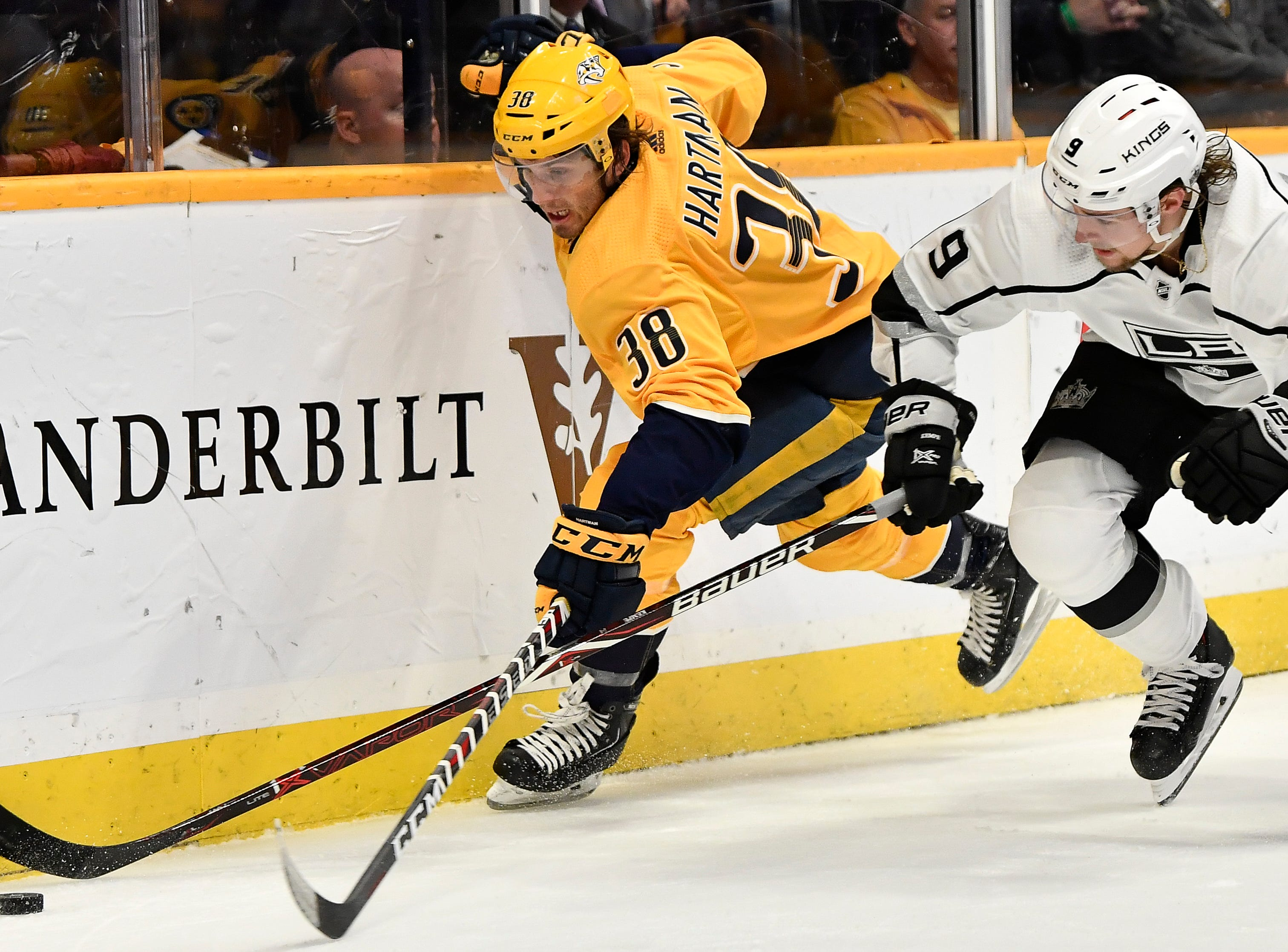 Predators right wing Ryan Hartman (38) battles for the puck with Kings center Adrian Kempe (9) during the first period at Bridgestone Arena Thursday, Feb. 21, 2019 in Nashville, Tenn.