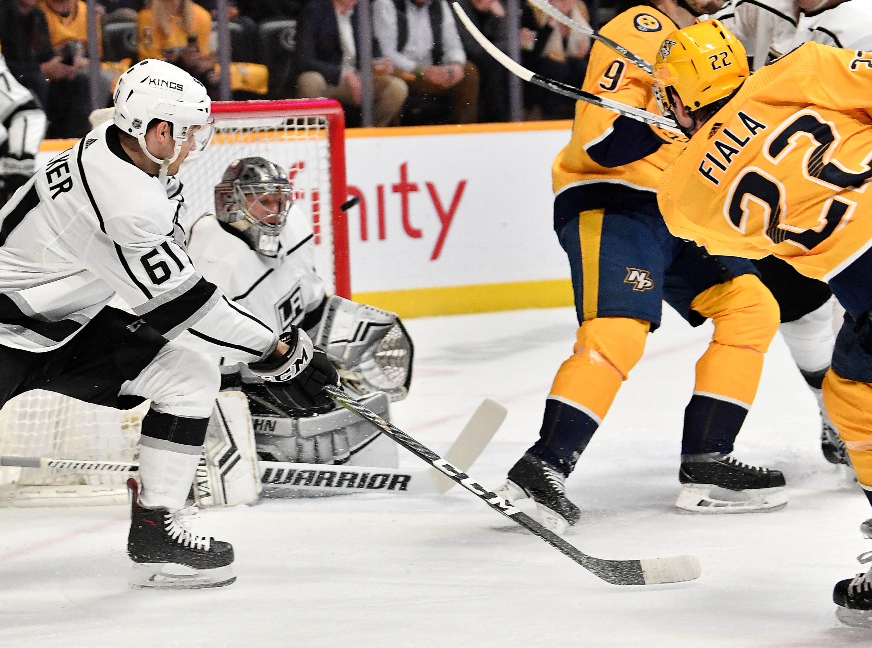 Predators left wing Kevin Fiala (22) tries to shoot the puck past Kings goaltender Jonathan Quick (32) during the first period at Bridgestone Arena Thursday, Feb. 21, 2019 in Nashville, Tenn.