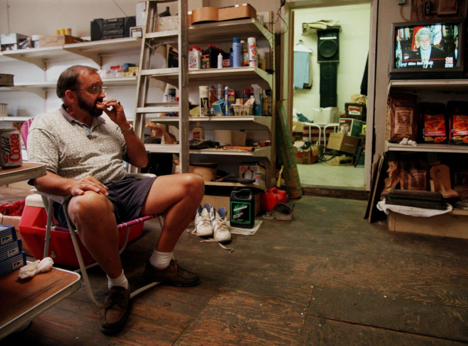 Joe Demarest, a regular customer at Terry's Market, relaxed with a freshly made sandwich while watching TV in the small Gallatin store.