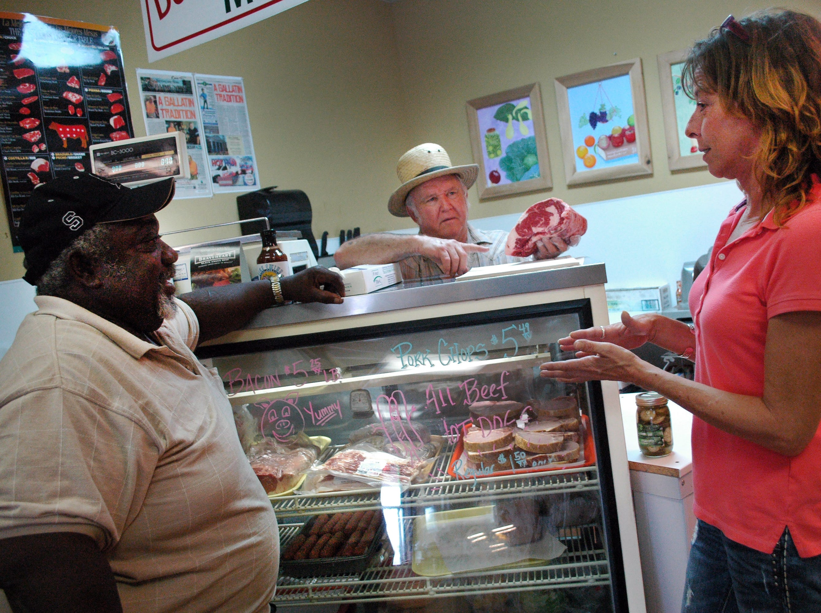 Henry Smith, left, and Tracy Terry chat at Don David's Gallatin store, Don's Market, which sells the meats and sandwiches residents used to find at Weyman Terry's butcher shop for six decades.